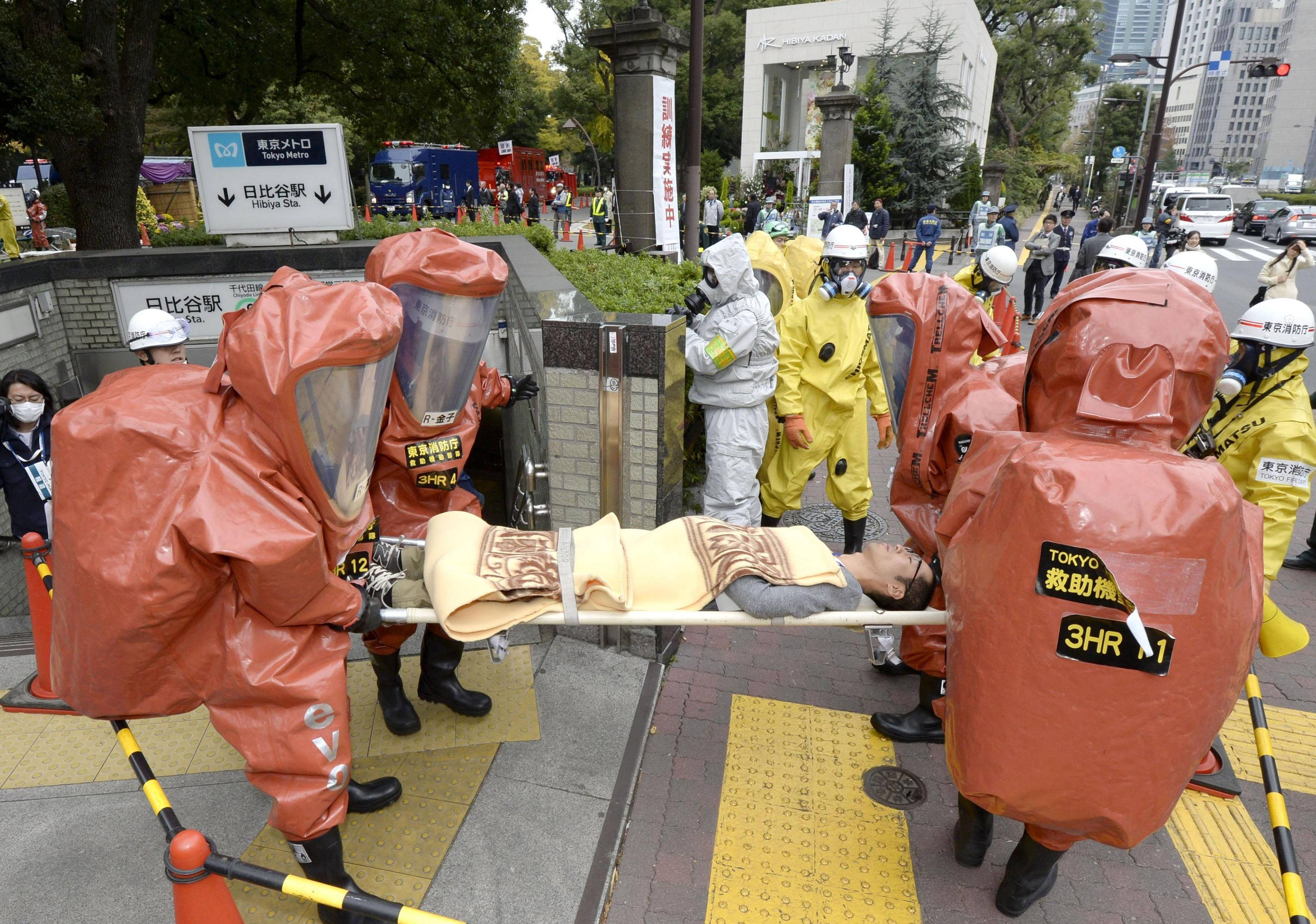 Firefighters practice evacuating victims from Tokyo's Hibiya Station as part of a terrorist-attack simulation on the Tokyo subway system on Thursday. | KYODO