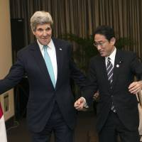 Foreign Minister Fumio Kishida and U.S. Secretary of State John Kerry meet on the margins of the Asia-Pacific Economic Cooperation forum summit in Beijing on Friday. | REUTERS