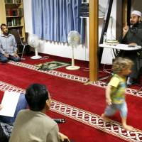Islamic scholar Mohsen Bayoumy delivers a sermon at Osaka Ibaraki Mosque in Ibaraki, Osaka Prefecture, in September. | KYODO