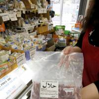 A growing number of stores in Japan sell products aimed at Muslims, such as this beef marked 'halal' in Arabic, seen in a store in September. | KYODO