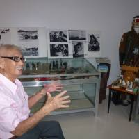 Daniel Dizon, 84, is seen in the makeshift kamikaze museum at his home in Angeles City, Pampanga province, on Oct. 5. Some of his most vocal critics are Filipinos whose relatives perished in World War II. | KYODO