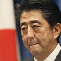 Prime Minister Shinzo Abe reacts to a question during a news conference at his official residence in Tokyo on Tuesday. | AP