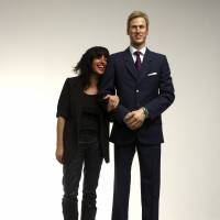 Artist Jennifer Rubell poses next to a wax effigy of Prince William exactly as he looked on the day of his engagement to Kate Middleton, in February 2011. Jiji Press said Friday that a photo it distributed Thursday night of what it said was the British royal turned out to be a wax figure from a New York museum instead. | BLOOMBERG