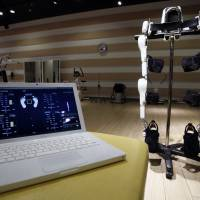 The Lower Limb Model HAL can be monitored from a laptop. This one shows data such as center of balance. | REUTERS