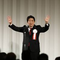 Prime Minister Shinzo Abe delivers a speech during a ceremony marking the 50th anniversary of the founding of Komeito, his coalition partner, in Tokyo on Monday. | REUTERS