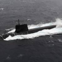 A Soryu class diesel-electric submarine is seen in this photo released by the Self-Defense Forces on Sept. 1. Australia wants to adopt a Japan-developed propulsion system for submarines it plans to commission. | REUTERS