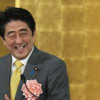 Prime Minister Shinzo Abe reacts as he speaks during a new year's gathering for business leaders in Tokyo on Jan. 7, 2014. | Bloomberg
