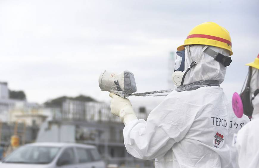 Tepco unable to halt tainted water flowing into tunnels at Fukushima
