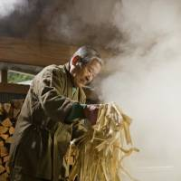 An artisan prepares Honminoshi, a type of 'washi' made in Gifu Prefecture. The process begins with the boiling of pulp from a mulberry tree. UNESCO added the venerable handmade paper to its Intangible Cultural Heritage list on Wednesday. | CULTURAL AFFAIRS AGENCY/ KYODO