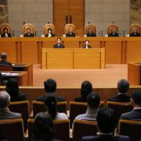 Justices sit in a courtroom at the Supreme Court in Tokyo on Wednesday for a trial questioning the constitutionality of the Upper House election of summer 2013.   KYODO