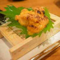 On the house: An uni (sea urchin) dish came courtesy of the restaurant ahead of a 'mountain' of tempura when our critic visited Tottuan in Osaka. | J.J. O'DONOGHUE