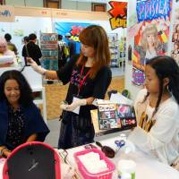 Girl power: Teenagers in Indonesia take part in an event led by Asia Kawaii Way, which aims to combine cosplay sensibilities, anime and manga fandom, and gal culture into one exportable package.   ASIA KAWAII WAY