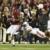 Alabama triumphs in wild Iron Bowl