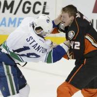 Canucks beat Ducks in shootout