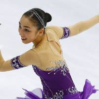 Raising the bar: Rika Hongo scored a personal-best 118.15 points in the free skate at the Cup of Russia on Saturday and won her first Grand Prix title. | AP