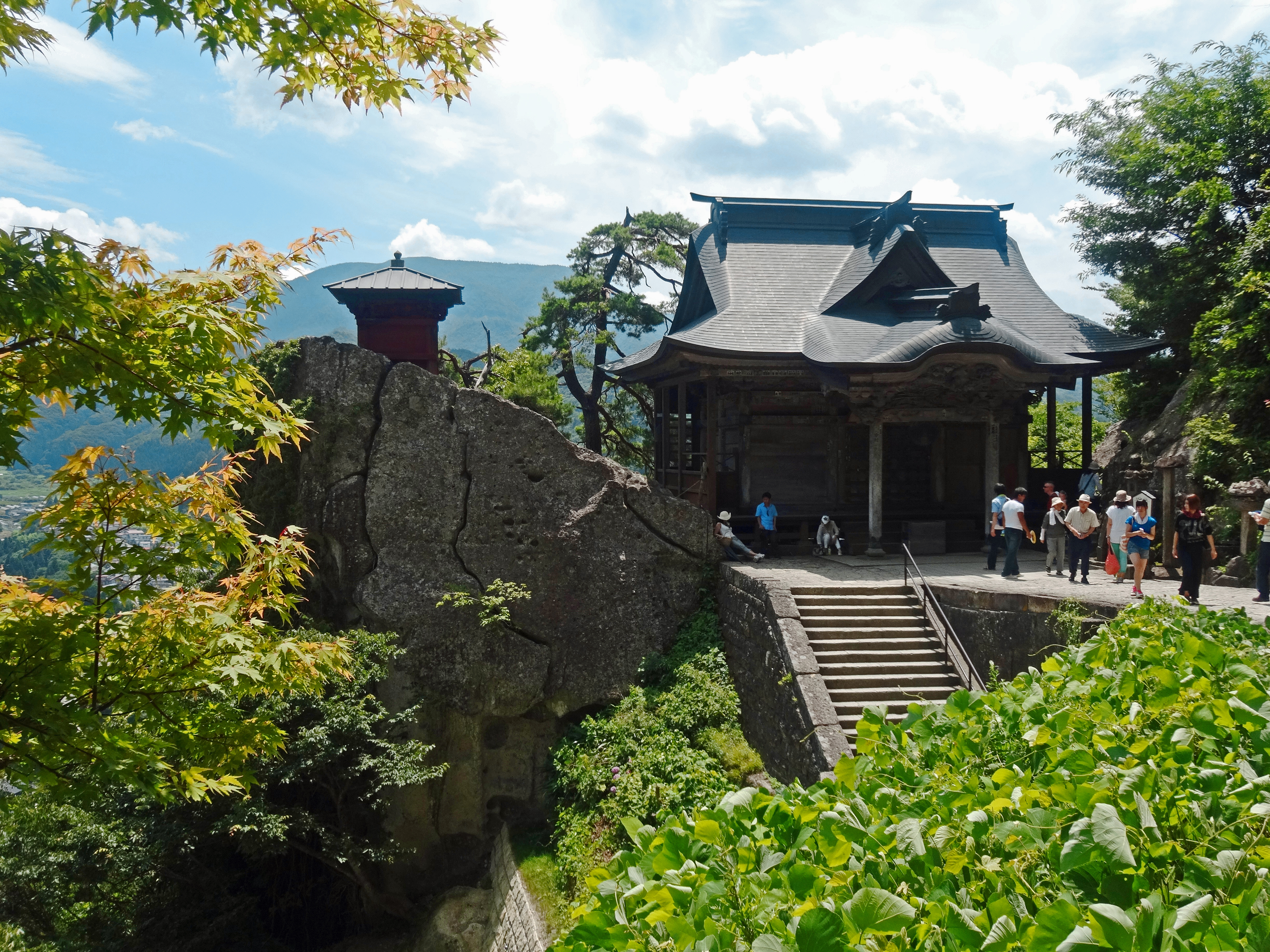 Mountain worship: Two picturesque buildings at the Risshakuji Temple complex look out across a valley. | MANDY BARTOK