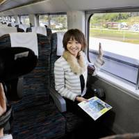Spreading the word: A typical joshi-ana (female announcer), who acts as a versatile television personality, records footage for an Aomori-based TV station.   KYODO