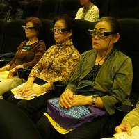 Sound and vision: A new type of head-mounted technology offers personal subtitles and descriptive audio for aurally and visually impaired moviegoers. | MASAMI ITO