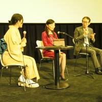 Breaking barriers: Takako Matsuda (far left), who scripts audio guides for the blind, emcees a talk with universal-design advisor Karin Matsumori (left), film director Masayuki Suo (center) and Naotaka Kacho (right), secretary-general of the Motion Picture Producers Association of Japan. | MASAMI ITO
