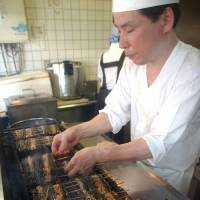 Over the coals: A chef prepares unagi (eel), which is considered cooling in summer. | AP