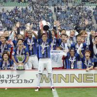 We are the champions: Yasuhito Endo leads the celebration after Gamba Osaka's 3-2 victory over Sanfrecce Hiroshima in the Nabisco Cup final. | KYODO