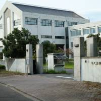 The East Japan Immigration Control Center in Ushiku, Ibaraki Prefecture. Many employees at the center are hired (by the Ministry of Justice) from the economically depressed area surrounding the facility. During the hiring process, they are often promised an eventual transfer to Tokyo. 'I don't think about the political implications of my work,' said one administrative employee in the center's detention section. 'Nobody here does.' | DREUX RICHARD