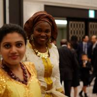 Elizabeth Onogwu, a native of Benue State in Nigeria and a doctoral candidate in anthropology at Yokohama National University, attends a celebration of Nigerian independence held by the Embassy of Nigeria in October. The number of African students at Japanese universities is growing steadily, according to the Japanese government. | DREUX RICHARD