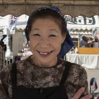 Here to stay: Mieko Matsuno sells seafood dishes at her market stall in Minamisanriku, Miyagi Prefecture. | SKYE HOHMANN