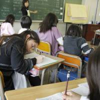 Doesn't add up: Japan spends less on education than most OECD countries but its students consistently outperform their Western counterparts in math. | AP