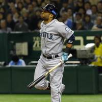 Pain during the game: Robinson Cano of the Seattle Mariners reacts after getting hit by a pitch from Japan's Yuki Nishi in the seventh inning of Game 3 of the MLB-Japan All-Star Series on Saturday at Tokyo Dome. | AP