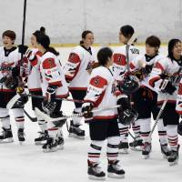 Pleased: Japan players congratulate each other after their Saturday victory over the Czech Republic at Shin-Yokohama Skate Center. | KYODO