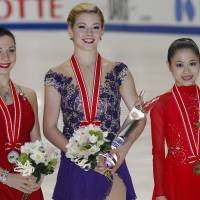 Recognition for success: Winner Gracie Gold (center), second-place skater Alena Leonova of Russia (left) and third-place finisher Satoko Miyahara are seen at the women's awards ceremony at the NHK Trophy on Saturday in Osaka.   AP