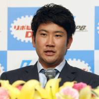 Giant performance: Yomiuri Giants pitcher Tomoyuki Sugano was on Wednesday honored as the 2014 Central League MVP. | KYODO