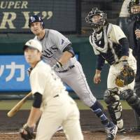 Ray of light: Tampa Bay's Evan Longoria hits a grand slam in the fifth inning of the Major League Baseball All-Stars' 8-7 win over a combined Hanshin Tigers-Yomiuri Giants team at Koshien Stadium on Tuesday night. | KYODO