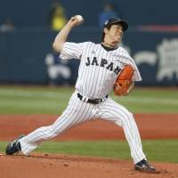 Remember the name: Starting pitcher Kenta Maeda delivers during the first inning of Japan's 2-0 win over the Major League Baseball All-Stars at Kyocera Dome on Wednesday night. Maeda pitched five scoreless innings in the first game of a five-game series. | KYODO