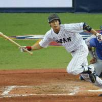 Welcome to Japan: Tetsuto Yamada drives in a run during the fourth inning of Japan's 2-0 win over the Major League Baseball All-Stars on Wednesday. | KYODO