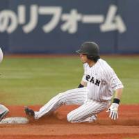 Opportunity knocks: Japan's Nobuhiro Matsuda steals second base ahead of Robinson Cano of the Seattle Mariners in the fourth inning of Wednesday night's game. | KYODO