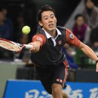 Back in action: Kei Nishikori hits a return to Andre Agassi during their exhibition match on Saturday in Tokyo. | AFP-JIJI