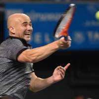 Still got the fire: Andre Agassi displays the fiery approach to the game that was on display throughout his long tennis career. | AFP-JIJI