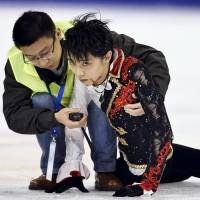 Hanyu places second in Cup of China despite bloody collision during warm-ups