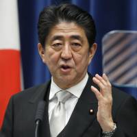 Prime Minister Shinzo Abe addresses a news conference at his official residence in Tokyo on Wednesday after taking office for a third term. | AP