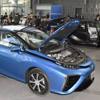 Toyota Motor Corp.'s new Mirai vehicle is displayed at the Miraikan museum in Tokyo on Monday. Toyota has become the world's first automaker to market a hydrogen-powered car. | KYODO