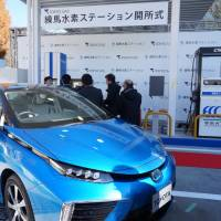 A Toyota Mirai fuel cell vehicle is displayed during a ceremony Thursday at Tokyo Gas Co.'s first commercial hydrogen refueling station in Nerima Ward, Tokyo. | KAZUAKI NAGATA