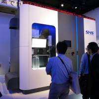 Honda Motor Co. displays a compact hydrogen station at CEATEC, Japan's biggest electronics and IT trade show, at the Makuhari Messe convention center in Chiba in October. | KAZUAKI NAGATA