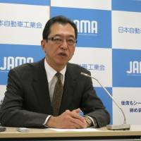 Fumihiko Ike, chairman of the Japan Automobile Manufacturers Associations, speaks to reporters Monday at the industry body's office in Tokyo. | KAZUAKI NAGATA