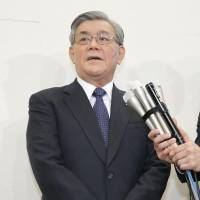 Kansai Electric Power Co. President Makoto Yagi answers questions from reporters Wednesday after asking the government to approve rate hikes for households. | KYODO