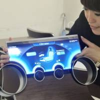 Sharp Corp.'s bendable liquid crystal display allows for a wide variety of applications. | KYODO