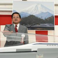 Koei Tsuge, president of Central Japan Railway Co., poses Wednesday as construction begins on a maglev station at JR Nagoya Station. Work began simultaneously on a maglev terminus at Tokyo's Shinagawa Station. | KYODO