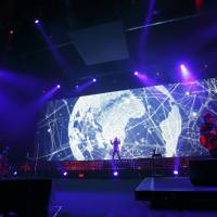 Anniversary special: The lights kick up as TM Network beings its show at Tokyo International Forum's Hall A on Dec. 10. | AVEX ENTERTAINMENT INC.; PHOTOGRAPH BY KAORU ABE