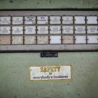 A sticker is seen next to a panel in the control room of the abandoned former Union Carbide Corp. pesticide plant in Bhopal, India. | REUTERS